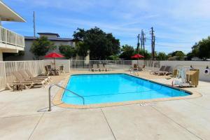 The swimming pool at or near Motel 6-Corpus Christi, TX - Northwest