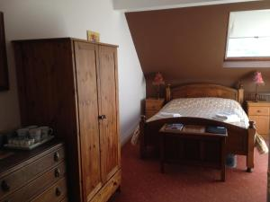 A bed or beds in a room at The Old School B&B