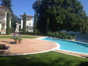 Der Swimmingpool an oder in der Nähe von Residence Ville Lago Lugano