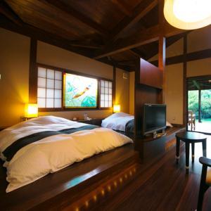 A bed or beds in a room at Flugel Kuju