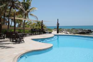 The swimming pool at or near Hotel Playa La Media Luna