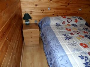 A bed or beds in a room at Camping Pla