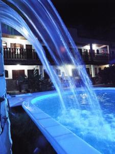 The swimming pool at or close to Pousada Alfa