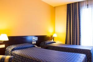 Ein Bett oder Betten in einem Zimmer der Unterkunft Atlantis by Atbcn