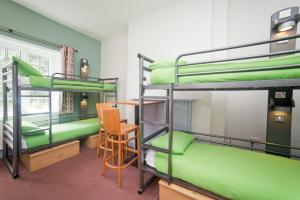 A bunk bed or bunk beds in a room at YHA Ilam Hall