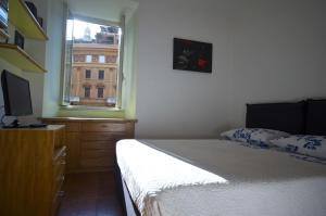 Un ou plusieurs lits dans un hébergement de l'établissement Apartment Arenula
