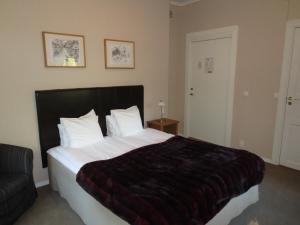 Säng eller sängar i ett rum på Hotell S:t Olof