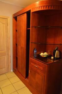 A kitchen or kitchenette at Mensvic Grand Hotel