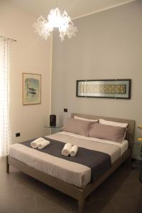 Letto o letti in una camera di Ponticello Apartments