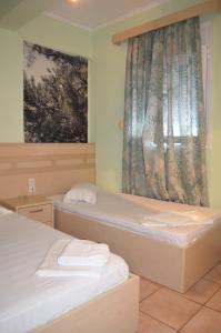 Ένα ή περισσότερα κρεβάτια σε δωμάτιο στο Fontana Rooms