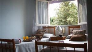 Una cama o camas en una habitación de Hotel Turingia