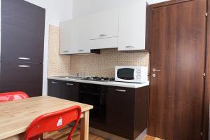 A kitchen or kitchenette at Santa Restituta in Cagliari Centre