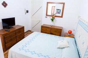 A bed or beds in a room at Santa Restituta in Cagliari Centre