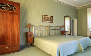 A bed or beds in a room at Hotel Mežotnes Palace