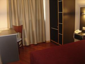 Cama o camas de una habitación en Hotel Alfinden