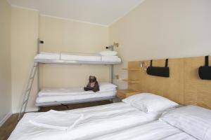 Våningssäng eller våningssängar i ett rum på Hotel Copenhagen Apartments
