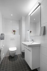 Ett badrum på Hotel Copenhagen Apartments