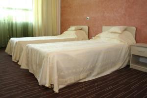 Un pat sau paturi într-o cameră la Hotel Zytto by Razvan Rat