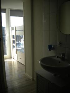 Ein Badezimmer in der Unterkunft Apartment Sandeman