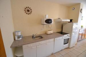 A kitchen or kitchenette at Apartments Gite le Picors