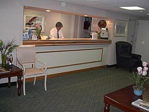 The lobby or reception area at Economy Inn