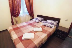 A bed or beds in a room at Maria Hotel