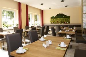 ห้องอาหารหรือที่รับประทานอาหารของ Hotel garni Grundmühle