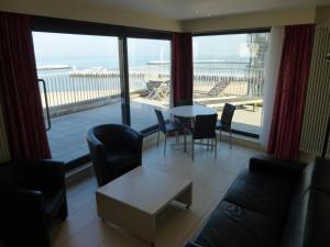 Een zitgedeelte bij El Mirador Quality Stay - Apartments