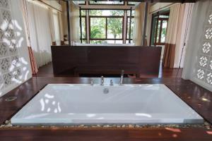 A bathroom at Amatapura Beachfront Villa 14, SHA Certified