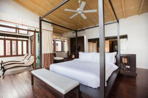 A bed or beds in a room at Amatapura Beachfront Villa 14, SHA Certified
