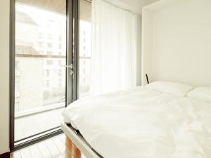 A bed or beds in a room at Industrie Business Hotel