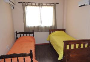 A bed or beds in a room at Maipu