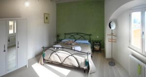 Een bed of bedden in een kamer bij B&B Piazza Vecchia