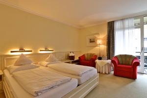 Ein Bett oder Betten in einem Zimmer der Unterkunft Wunsch Hotel Mürz - Natural Health & Spa Hotel