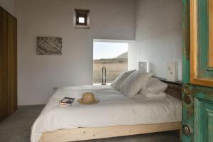 A bed or beds in a room at Buenavista Lanzarote Country