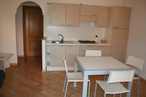 A kitchen or kitchenette at Residence Olimpo
