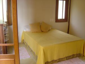 A bed or beds in a room at Holiday home Ilhabela