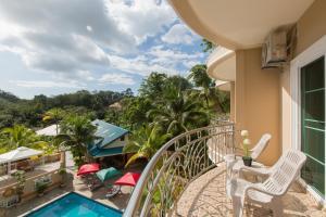 A balcony or terrace at Patong Rai Rum Yen Resort