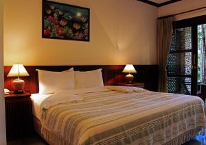 A bed or beds in a room at Krabi Sands Resort