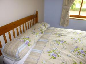 A bed or beds in a room at Tulloch