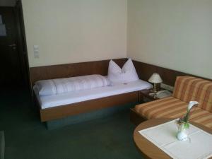 Кровать или кровати в номере Hotel Stadt Witzenhausen
