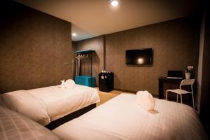 Кровать или кровати в номере C U Inn Bangkok