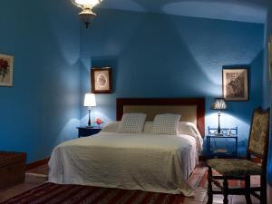 Cama o camas de una habitación en Haciendas del Valle - Casa San Miguel