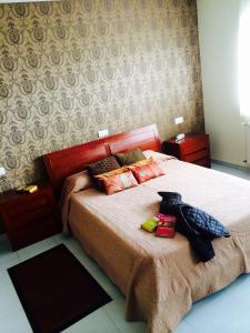 Cama o camas de una habitación en Hotel Casa Jurjo