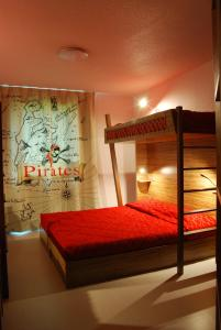 A bunk bed or bunk beds in a room at Hôtel Du Parc - Pirates