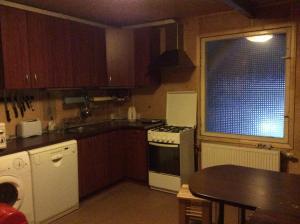 A kitchen or kitchenette at Jaunmārtiņi
