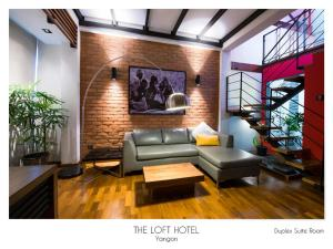A seating area at The Loft Hotel Downtown Yangon