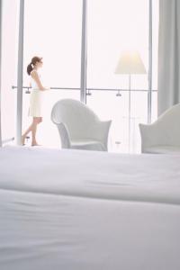 A bed or beds in a room at Estalagem Da Ponta Do Sol