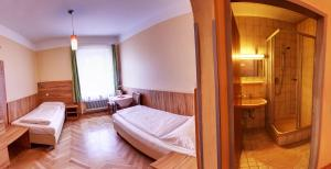 A bed or beds in a room at Pension Jahn