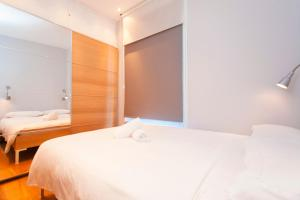 A bed or beds in a room at ItalianFlat - Camden